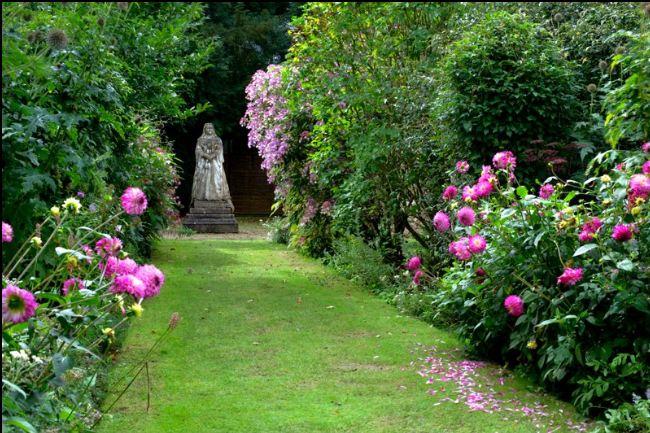 flower garden with statue of Queen Victoria