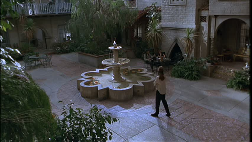 large fountain in courtyard of apartment complex