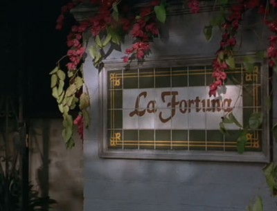 sign saying La Fortuna in front of apartment complex in 'Til There Was You movie