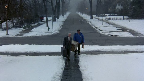 Steve Martin and John Candy walking up to house on snowy day
