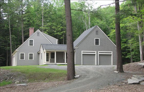 side exterior view of Cape with two car garage and porch