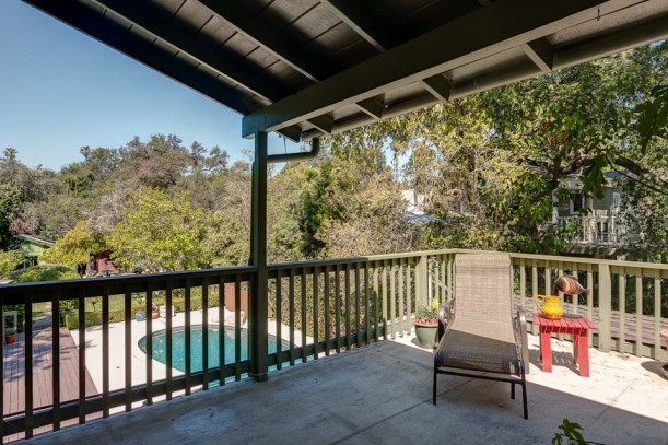 back deck overlooking the pool