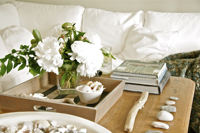 coffee table with vase filled with flowers