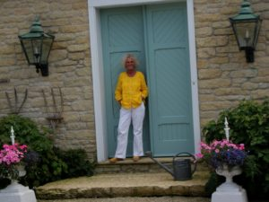 Suzy Stout at her Illinois farmhouse-turquoise front doors