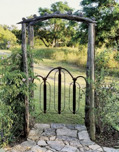 rusted headboard turned into gate