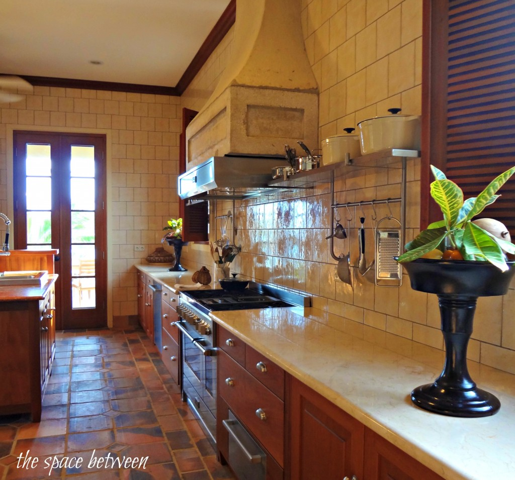kitchen with large vent hood over range