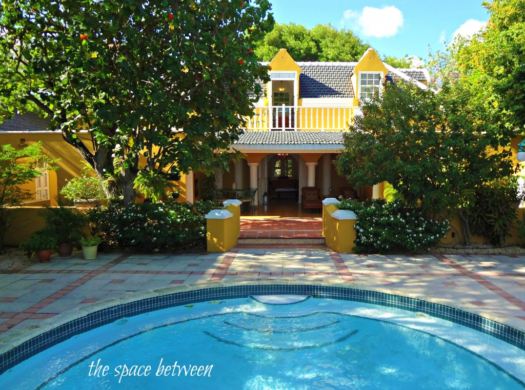 pool behind yellow house