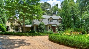 front exterior of Dutch Colonial style home for sale in Atlanta