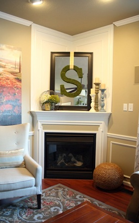 corner fireplace with mirror over mantel