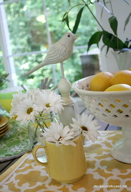 daisies lemons and bird on sunroom table