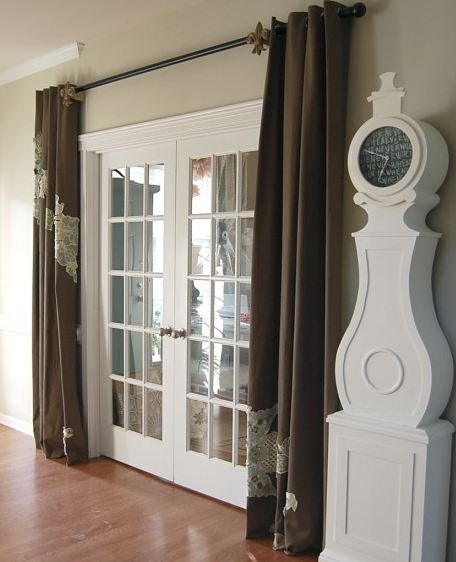 french doors with curtains and tall clock in Myquillyn\'s entry hall