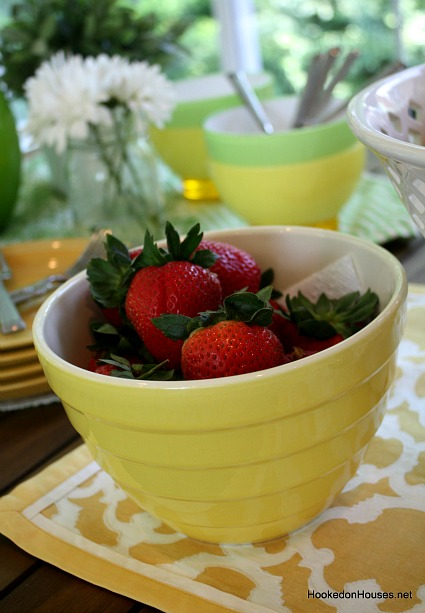 red strawberries in yellow bowl sunroom