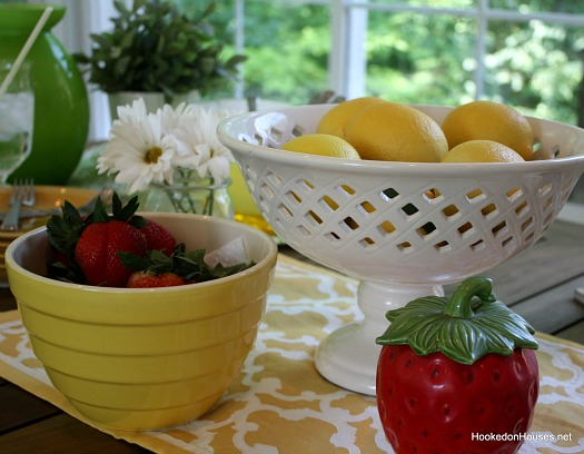 strawberries and lemons on sunroom table
