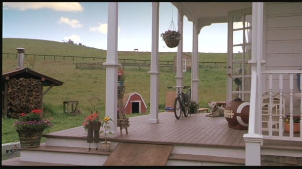 front porch of farmhouse with bike sitting on it