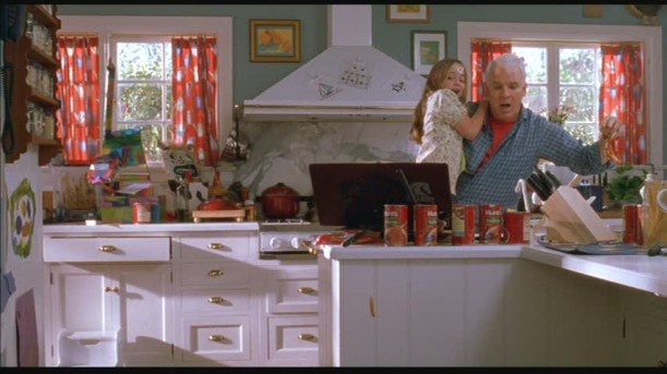 Steve Martin cooking in kitchen in Cheaper By the Dozen
