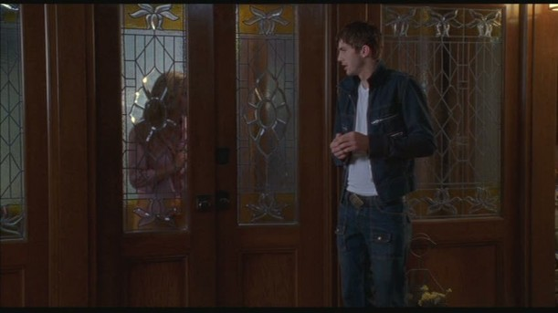 Ashton Kutcher in front of entry door