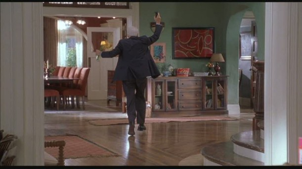 Steve Martin walking through entry hall