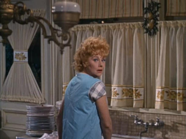 Lucille Ball standing at the sink in Yours Mine and Ours movie kitchen