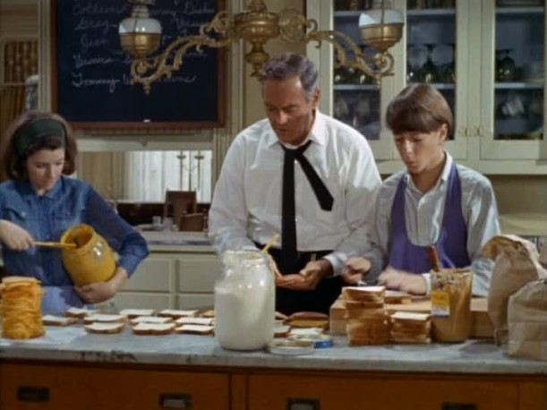 Henry Fonda making lunches in the kitchen for family