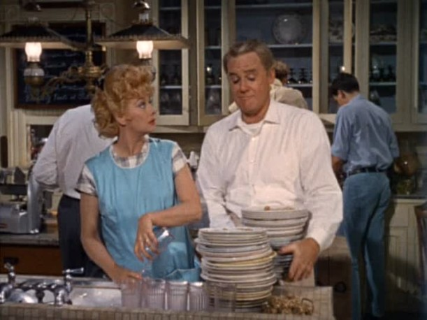 Lucille Ball and Henry Fonda washing dishes in the kitchen