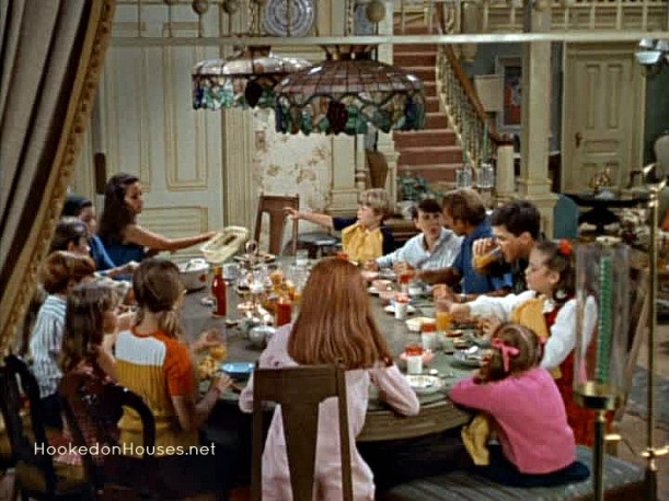 family sitting around large dining table