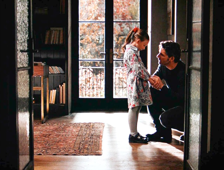 Henry talks with daughter inside house
