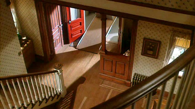 looking down staircase to front hall