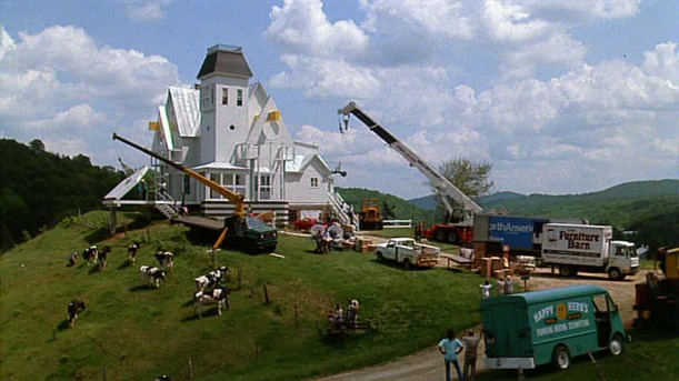 giving the Beetlejuice house a makeover with cranes and workers