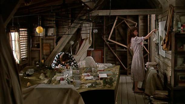 Geena Davis and Alec Baldwin in the attic