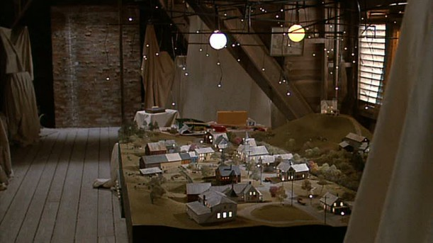 model of town buildings and roads in attic