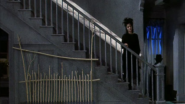 Winona Ryder walking downstairs into remodeled living room of house