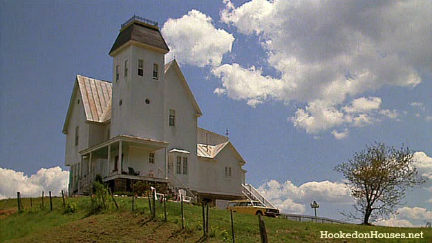 exterior of white Beetlejuice house on a hill