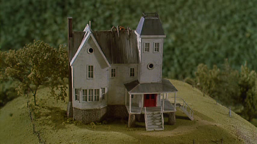 Beetlejuice movie model house with spider hooked on houses for Model house movie