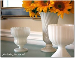 Milk glass with sunflowers in dining room-cover