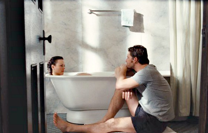 Clare in the bathtub talking to Henry