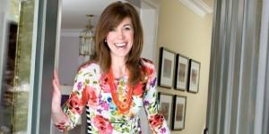 Sarah Richardson standing in open doorway of house