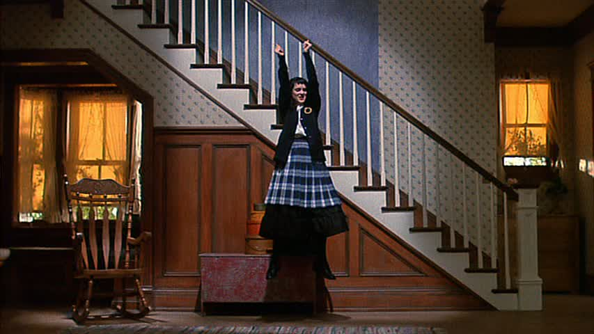 Winona Ryder levitates in front of staircase in Beetlejuice movie