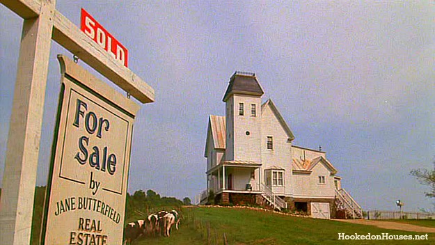 Beetlejuice house on hill with For Sale sign in front