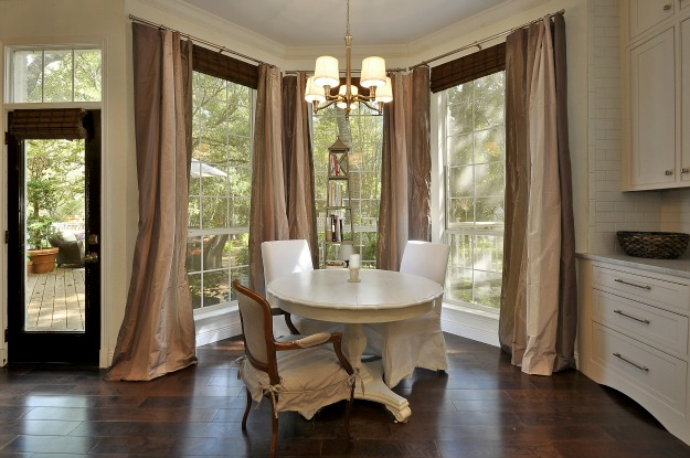 round dining table with chairs in bay window