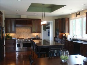 Carrie's dark wood kitchen with black island