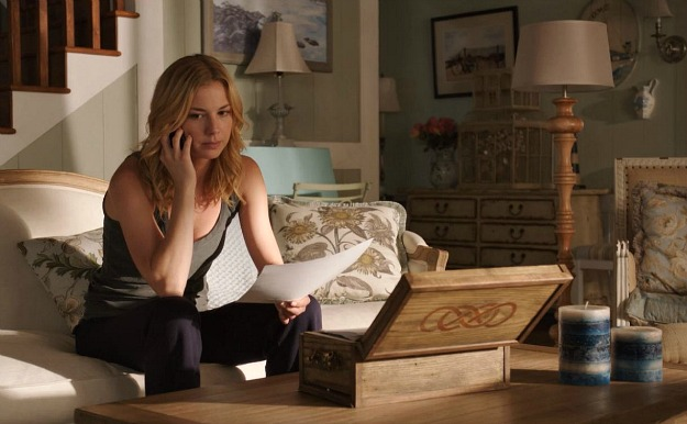 Emily VanCamp sitting on a table