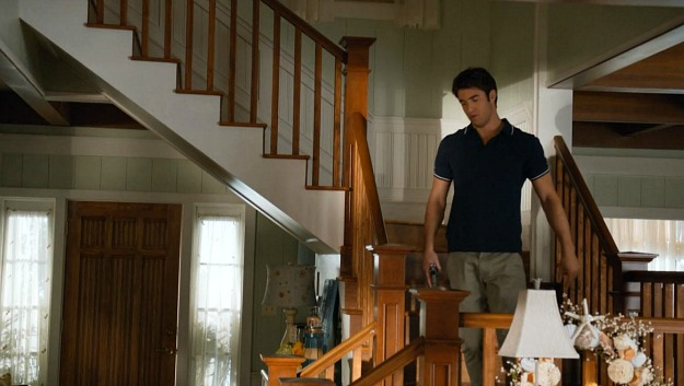 Daniel coming down the stairs of the beach house
