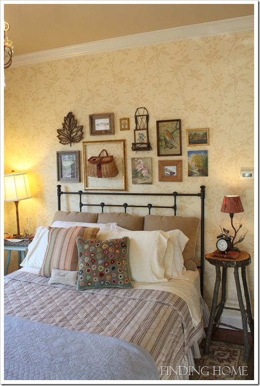 A bedroom with iron headboard