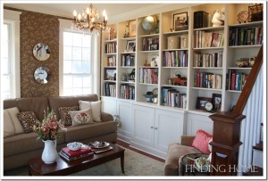 A living room filled with furniture and a book shelf