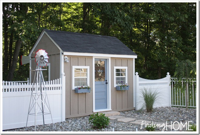 playhouse in backyard with window boxes
