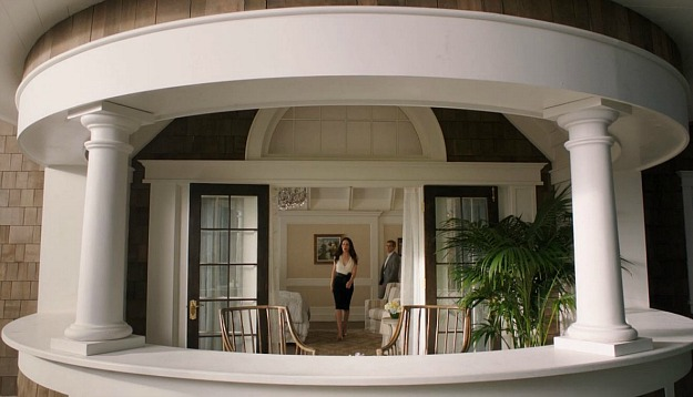 Victoria walking through her bedroom on her way to the turret balcony