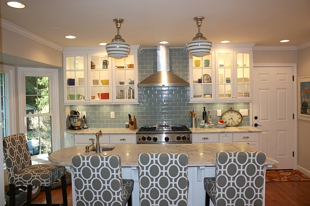 kitchen with blue gray subway tile on backsplash