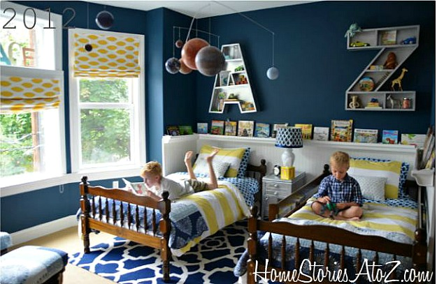 boys bedroom after makeover with teal blue walls and book rail
