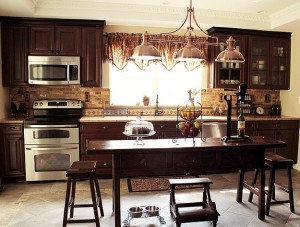 Jodie's newly remodeled kitchen with dark wood cabinets and island
