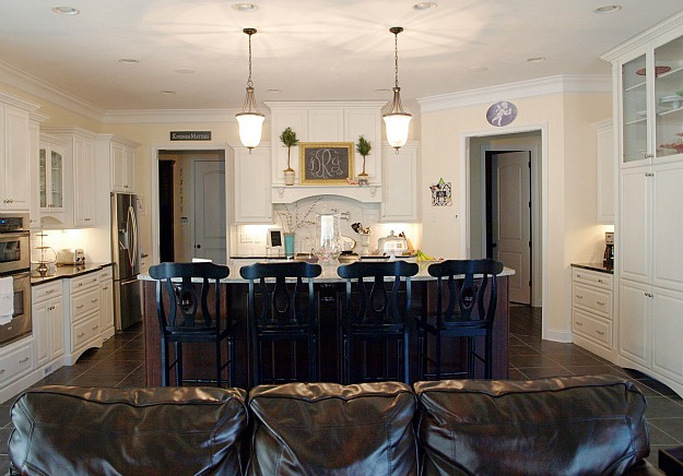 kitchen island with black barstools